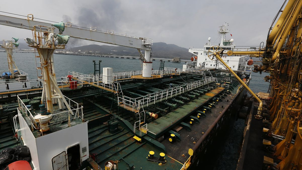 FILE - In this May 25, 2020 file photo, the Iranian oil tanker Fortune is anchored at the dock of the El Palito refinery near Puerto Cabello, Venezuela.  U.S. officials said Thursday, Aug. 13, 2020, that the Trump administration has seized the cargo of four tankers it was targeting for transporting Iranian fuel to Venezuela as it steps up its campaign of maximum pressure against the two heavily sanctioned. (AP Photo/Ernesto Vargas, File)