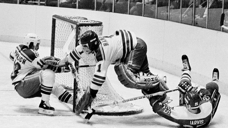 FILE - In this Dec. 7, 1983, file photo, Washington Capitals' Doug Jarvis (25), right, scores a...