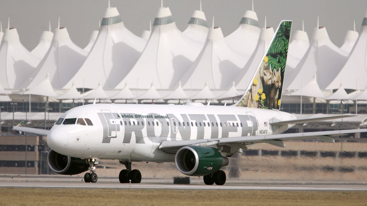 A Frontier Airlines flight departs from the west runway of Denver International Airport