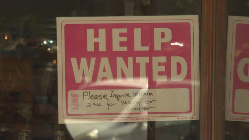 Help wanted sign in Downtown Grand Junction on Main St.