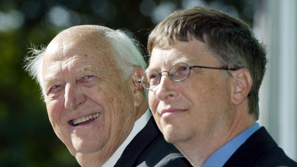 FILE - In this Sept. 12, 2003 file photo, William H. Gates Sr., left, smiles while sitting next to his son, Bill Gates Jr., during the dedication and grand opening of the William H. Gates Hall, new home of the University of Washington School of Law in Seattle. Bill Gates Sr., a lawyer and philanthropist and father of Microsoft co-founder Bill Gates, died Monday, Sept. 14, 2020, at age 94.