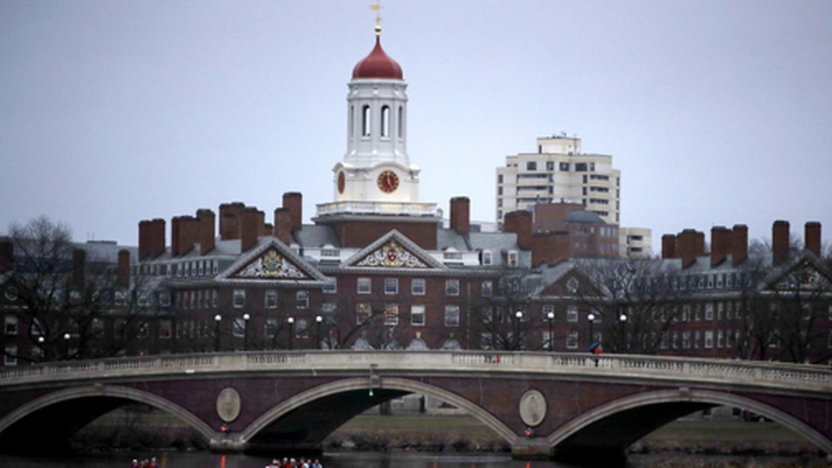 In this March 7, 2017 file photo, rowers paddle down the Charles River past the campus of Harvard University in Cambridge, Mass. (AP Photo/Charles Krupa, File)