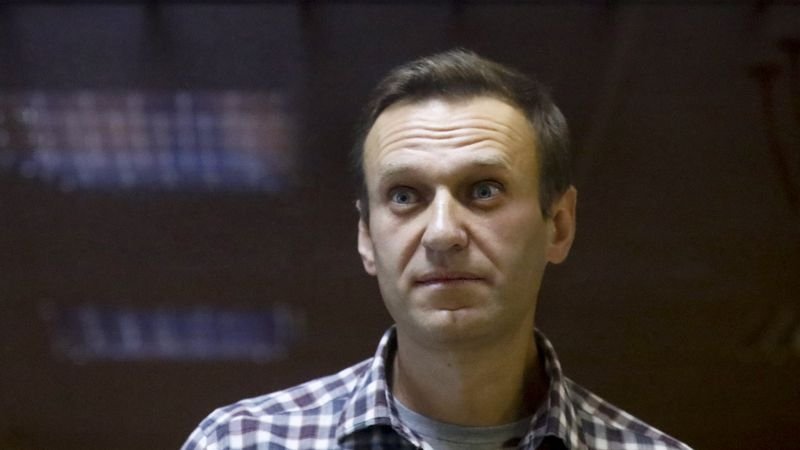 In this Saturday, Feb. 20, 2021 file photo, Russian opposition leader Alexei Navalny stands in...
