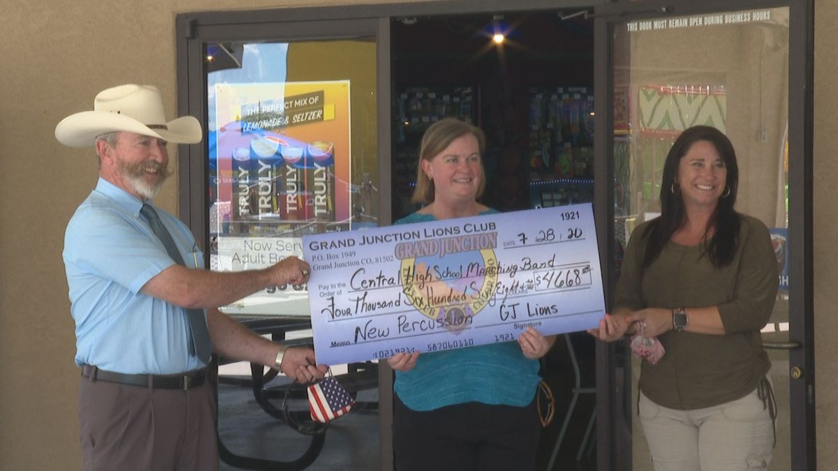 Grand Junction Lions Club gives check to Central High School Marching Band