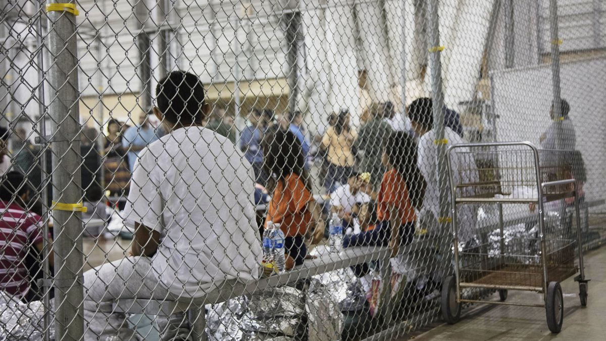 FILE - In this June 17, 2018 file photo provided by U.S. Customs and Border Protection, people...