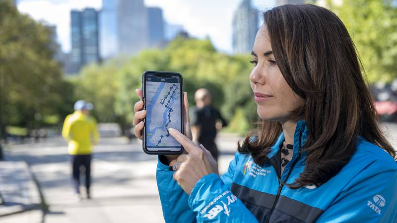 At the finish line of the TCS New York City Marathon in Central Park, Haley Price, head of...