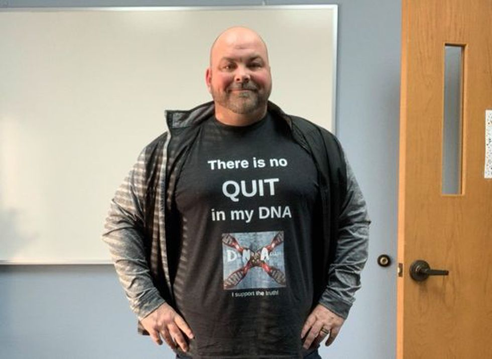 """B.J. Olson wears his """"There is no quit in my DNA"""" shirt after fighting relentlessly with South..."""