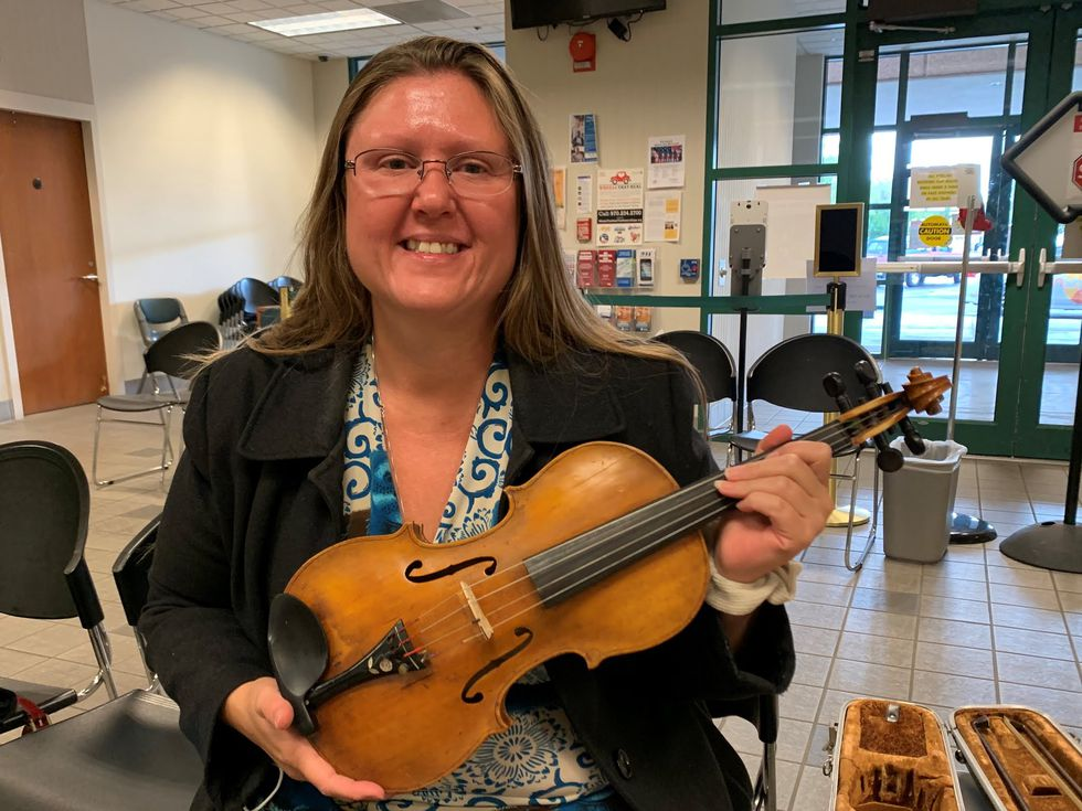Samantha Berryman was reunited with her violin, which has been passed down through her family...