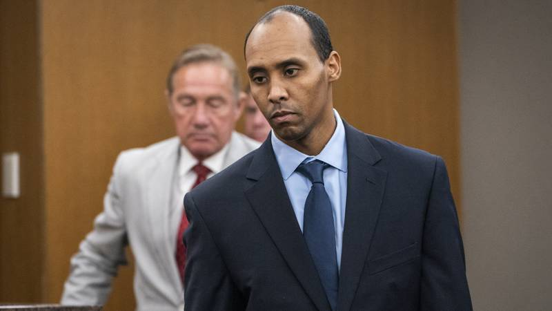In this Friday, June 7, 2019, file photo, Former Minneapolis police officer Mohamed Noor walks...