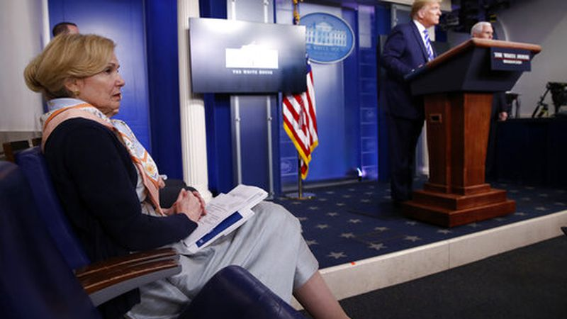 Dr. Deborah Birx, White House coronavirus response coordinator, listens as President Donald Trump speaks about the coronavirus in the James Brady Press Briefing Room of the White House, Thursday, April 23, 2020, in Washington. (AP Photo/Alex Brandon)