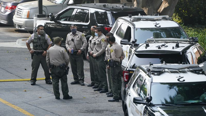Police officers stand outside St. Francis Medical Center on Monday, Sept. 14, 2020, in Lynwood,...