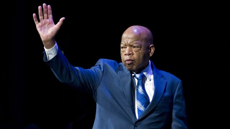 FILE - In this Jan. 3, 2019 file photo, Rep. John Lewis, D-Ga., waves to the audience during...