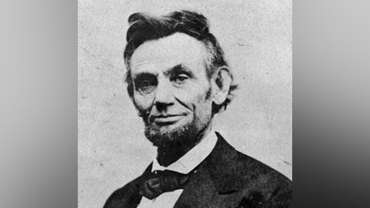 A lock of Abraham Lincoln's hair along with a bloodstained telegram about his 1865 assassination have been sold at auction for more than $81,000.