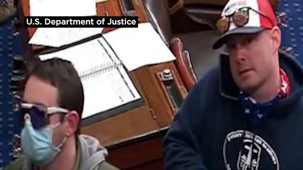 Leo Brent Bozell IV, right, of Palmyra, Pennsylvania, was charged with obstructing an official...