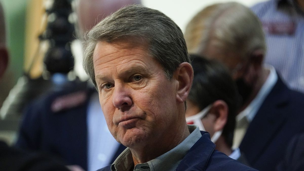 FILE - In this April 3, 2021 file photo, Georgia Gov. Brian Kemp listens to a question during a...