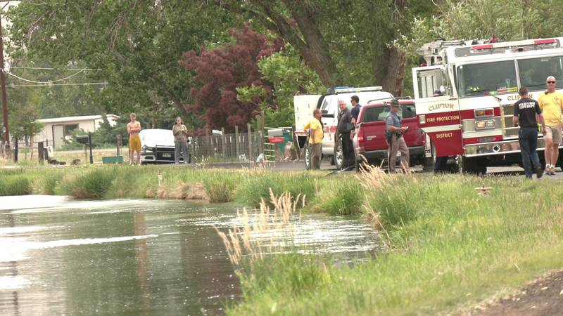 Crews on scene after body discovered in overturned vehicle in canal.