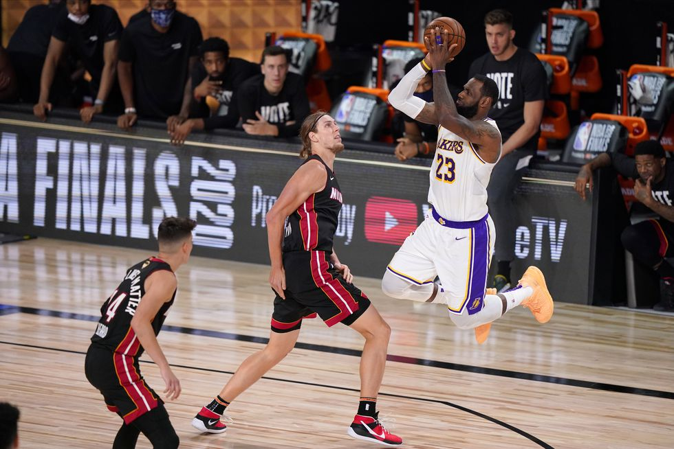 Los Angeles Lakers' LeBron James (23) takes a shot over Miami Heat's Kelly Olynyk (9) during...