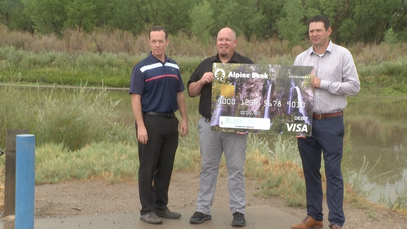 Rivers Edge West receives check from Alpine Bank