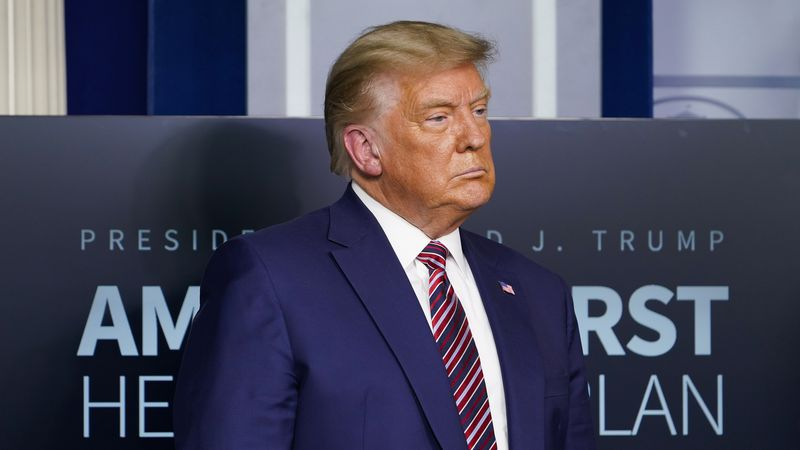 FILE - In this Nov. 20, 2020 file photo, President Donald Trump listens during a news...