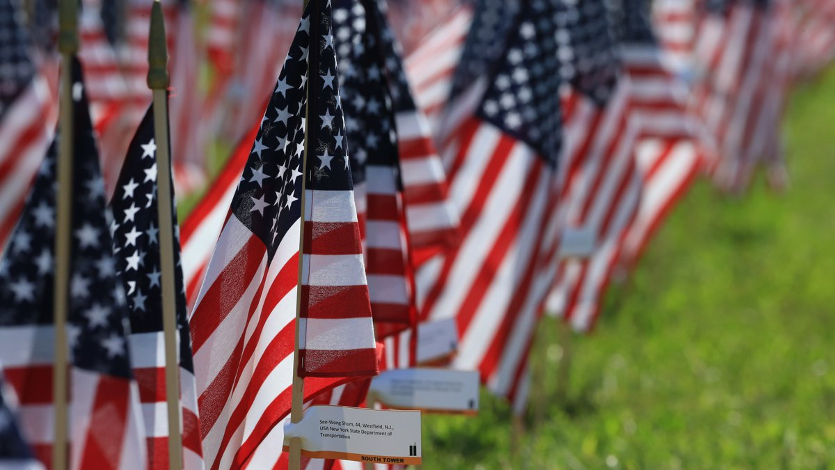 Flags bearing the names of victims of the 9/11 attacks stand in Memorial Park in Omaha, Neb.,...