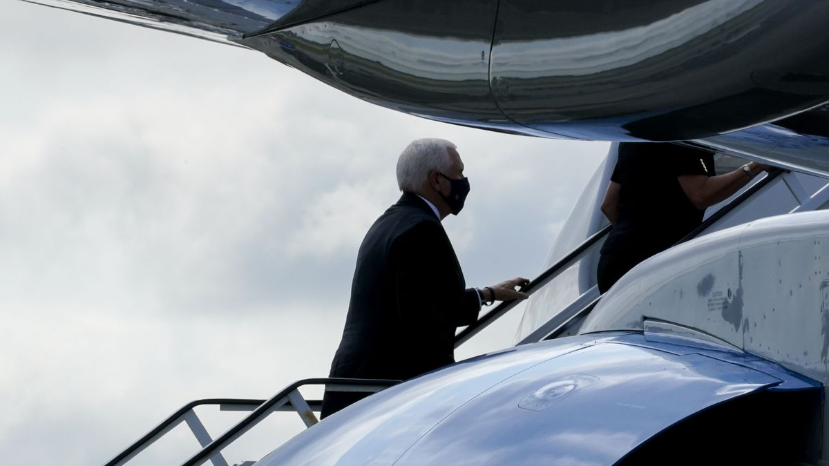 Vice President Mike Pence boards Air Force Two after attending a ceremony marking the 19th anniversary of the 9/11 terrorist attacks at the National September 11 Memorial & Museum, Friday, Sept. 11, 2020, in New York.
