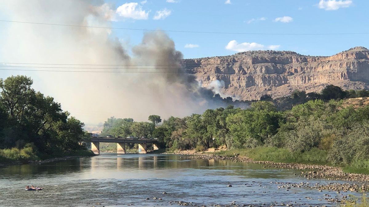 Brush fire forces evacuations in Palisade.