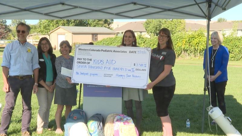 Western Colorado Pediatrics Associates donates check to their own program called Kids Aid...