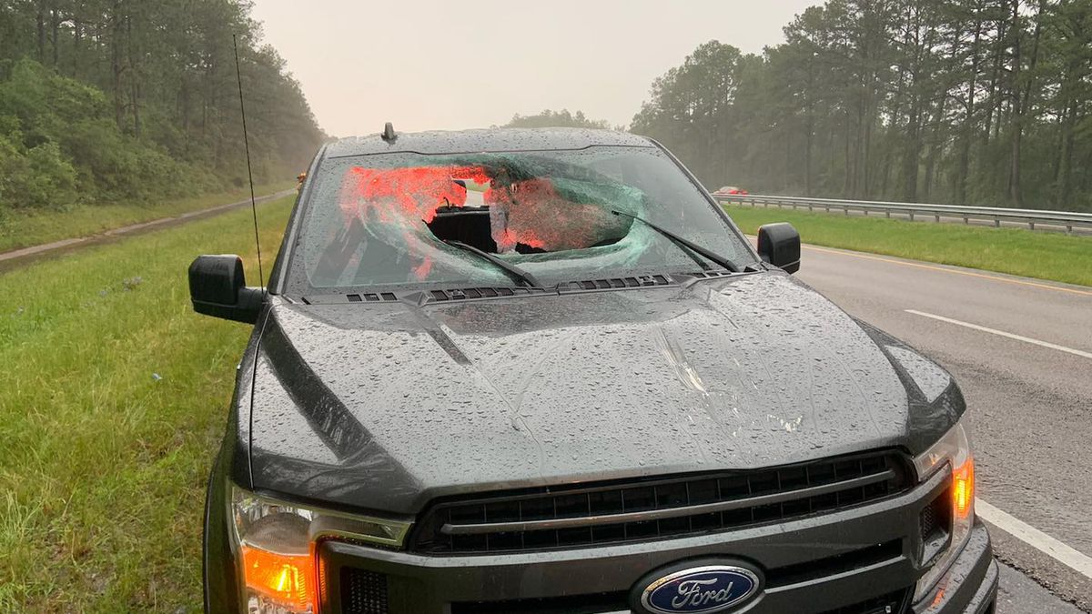 A lightning strike hit I-10 Monday morning, sending a piece of the road through a truck's...