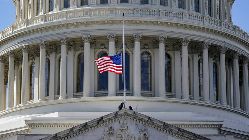 The American flag is set to half-staff at the Capitol in Washington, Monday, Oct. 18, 2021, in...