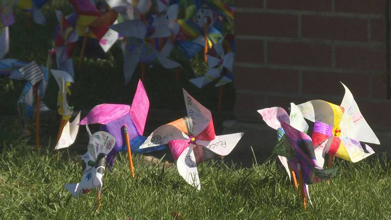 The pinwheels the students made are on display outside the school's front entrance.