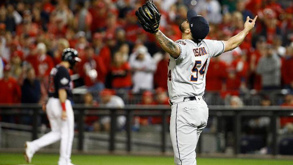 Houston Astros relief pitcher Roberto Osuna celebrates their teams win against the Washington Nationals in Game 3 of the baseball World Series Saturday, Oct. 26, 2019, in Washington. The Astros won 4-1. (AP Photo/Patrick Semansky)