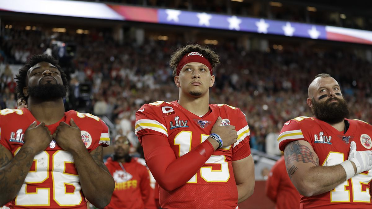 Kansas City Chiefs' Damien Williams (26), Patrick Mahomes (15), and Anthony Sherman (42) stand during the national anthem before the NFL Super Bowl 54 football game against the San Francisco 49ers Sunday, Feb. 2, 2020, in Miami Gardens, Fla.(Source: AP Photo/Seth Wenig)