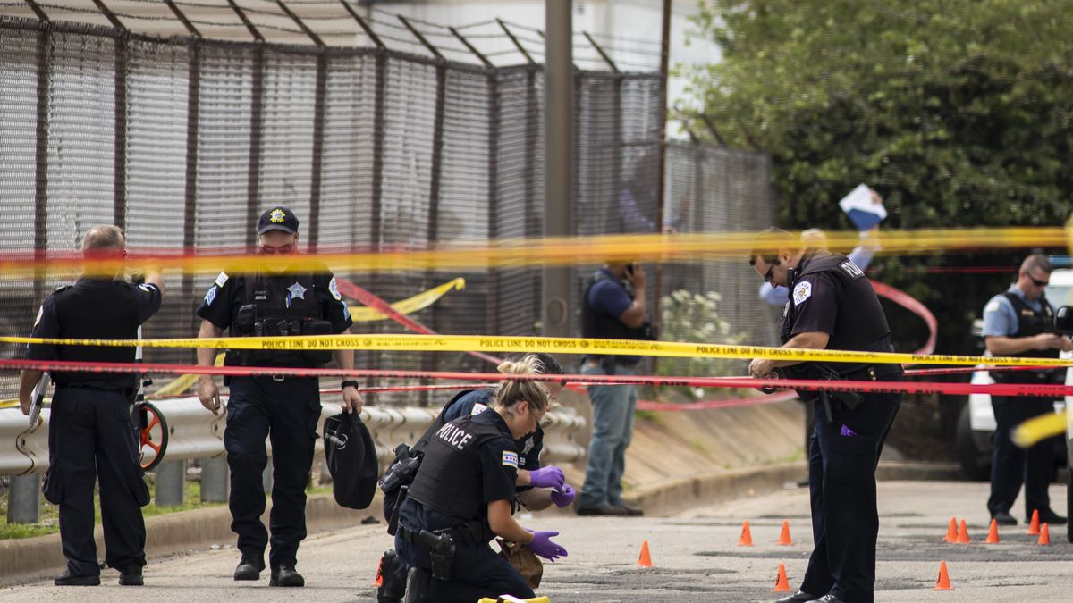 Chicago Police investigate at the 25th District station on the Northwest Side, after several...