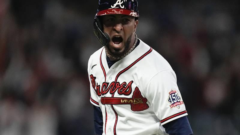 Atlanta Braves' Eddie Rosario celebrates after hitting a three run home run during the fourth...