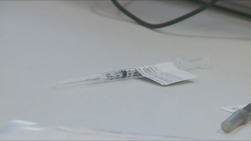 A Covid-19 vaccine waiting to be inoculated in someone's arm.